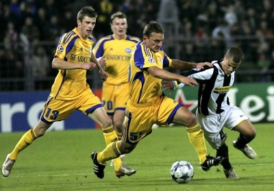 Juventus Sebastian Giovinco, right, vies for the ball with FC Bate's Borisov Aleksandr Yurevich, second from right, Pavel Nekhaychik, left, during their Champions League Group H soccer match at the Dinamo stadium in Minsk, Tuesday, Sept. 30, 2008. The match ended in a 2-2 draw. (AP Photo/Dmirty Nikolayev)